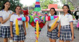 Alumnos de la U de Colima elaboran piñatas navideñas para niños de albergues